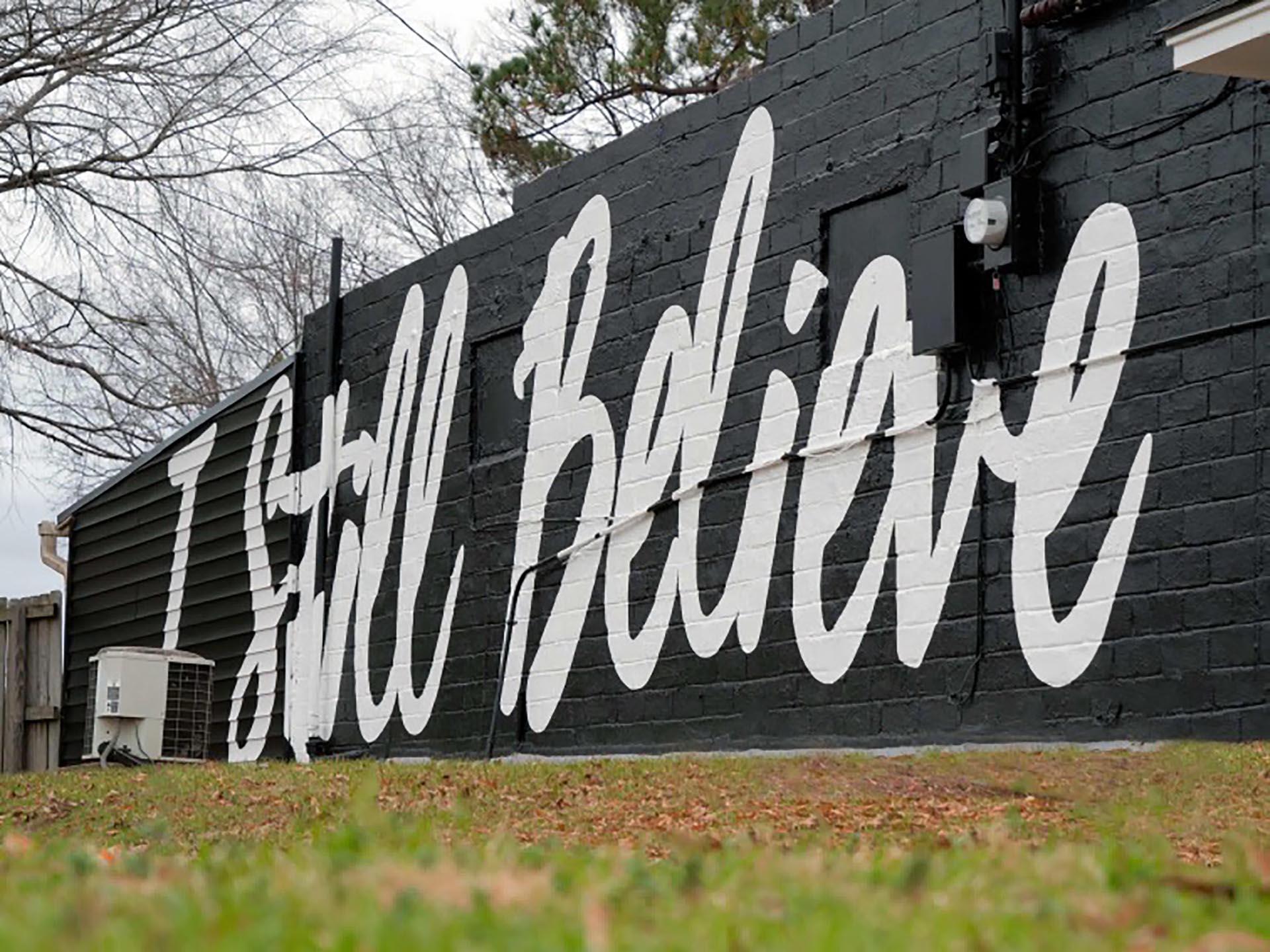 I still believe - lettering mural - Dace Kidd - Mural Artist Tx- window painting - Dace Kidd - Mural Artist Tx