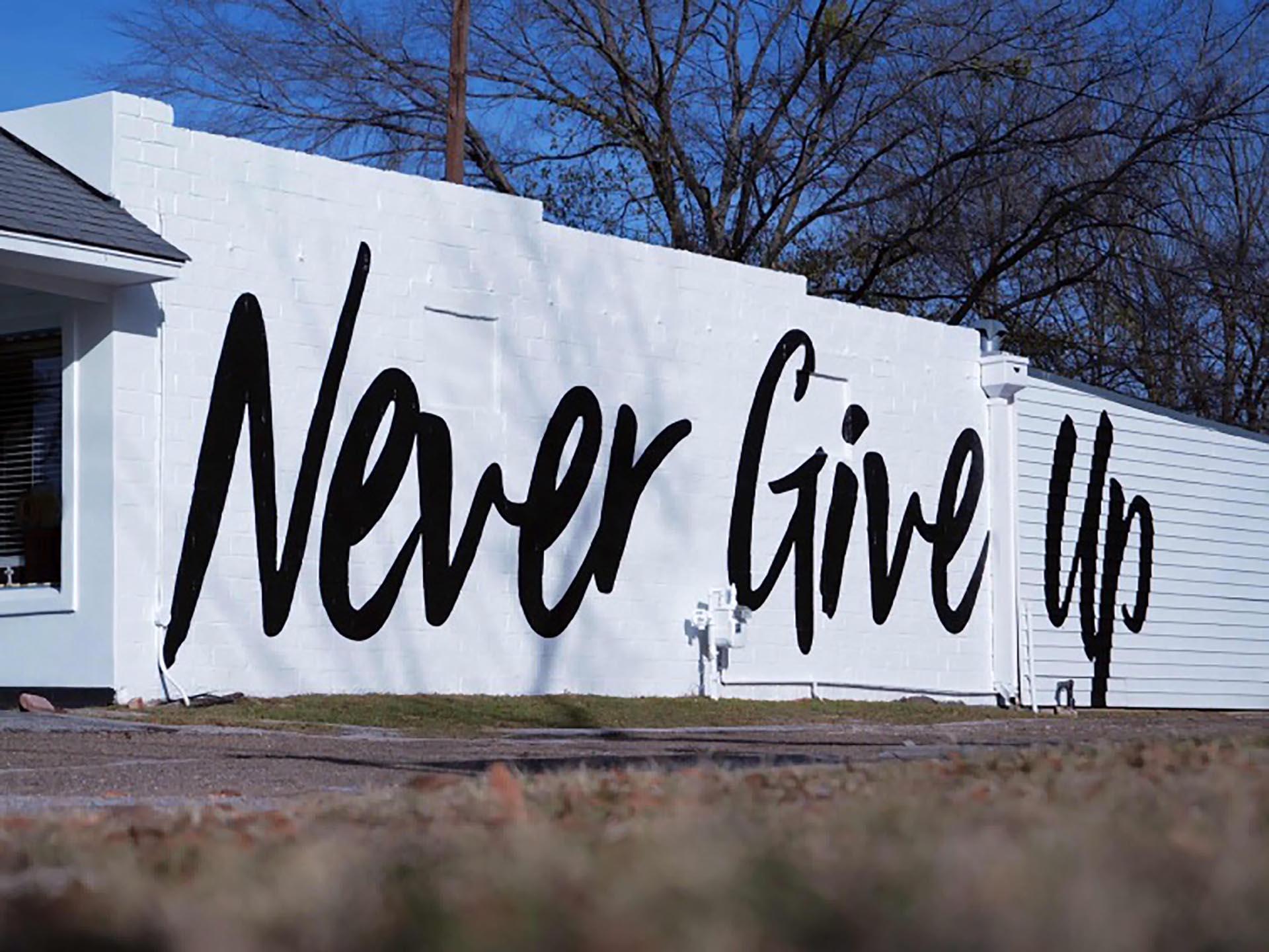 Never Give Up - lettering mural - Dace Kidd - Mural Artist Tx